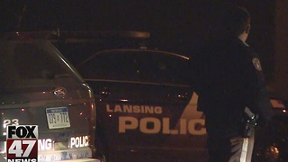 Armed robber on the run in Lansing - Video