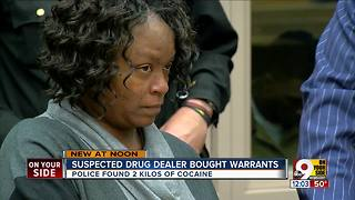 Woman charged with selling sealed search warrants