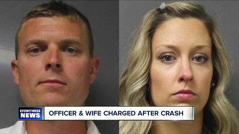 Officer and wife charged after crash