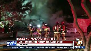 Man rescued from garage fire