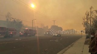 Firefighters battle blaze in smoke filled Ventura County - Video