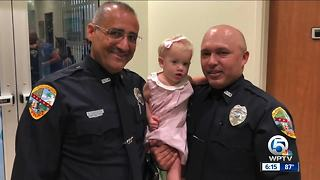 Palm Beach Gardens officers save choking baby - Video