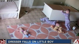 Dresser falls on little boy - Video