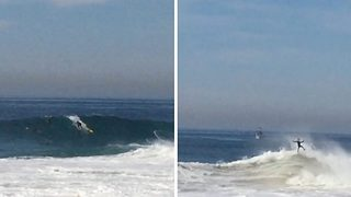 Catch the wave! Huge crash sees surfer get tossed about like a rag doll