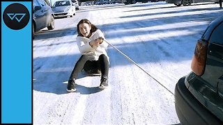 Friends Beat the Winter Blues by Sliding Behind a Car - Video