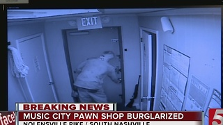Smash-&-Grab Pawn Shop Burglar Seen On Surveillance - Video