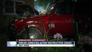 Woman slams SUV into parked vehicles, takes down fence before hitting house in Bay Park