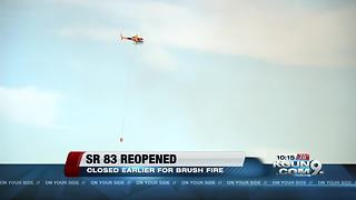 SR 83 is fully reopened after being closed for several hours Wednesday due to a brush fire
