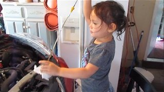 Young DIY Queen Demonstrates How to Change Oil - Video