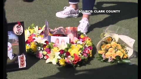 Heart shaped wreath placed in front of Welcome to Las Vegas sign to honor COVID-19 victims
