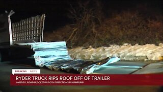 Roof ripped off box truck closing Amsdell Road in Hamburg