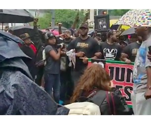Protesters for Antwon Rose March Through Rain in Pittsburgh's Juneteenth Parade - Video