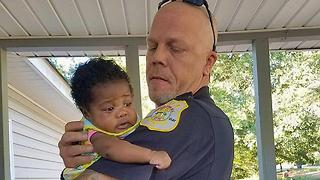 Cop Becomes Godfather For Baby He Saved - Video