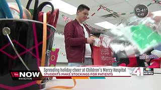 High school students stuff stockings for kids fighting cancer - Video