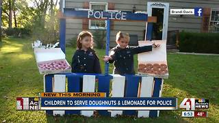 Children set up donut stand in Overland Park to thank local officers - Video