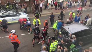 Cyclists crash into parked car during Tour of Britain - Video