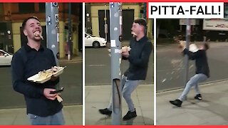 Drunk man drops kebab after leaning on lamppost