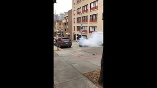 Truck burns rubber after ramming into parked van - Video