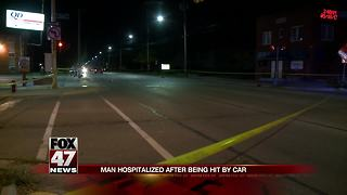 Man crossing street hit by truck, critically injured - Video