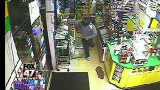 Police searching for robber of Buddy's gas station - Video