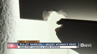 Bullet narrowly misses woman's head - Video