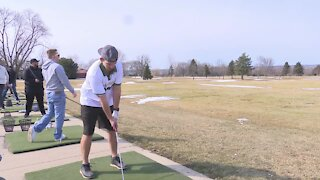Golfers enjoy warmer weather