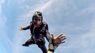 Skydive high-five – Jumpers put their hands together at 10,000ft  - Video