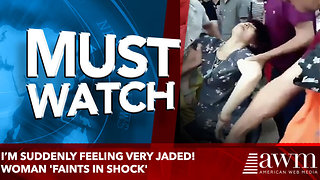 I'm suddenly feeling very jaded! Woman 'faints in shock' - Video