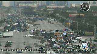 Section of Okeechobee Blvd. shut due to police activity - Video