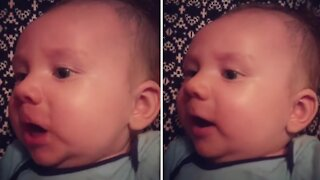 Sweet baby attempts to sing 'You Are My Sunshine' with his mom