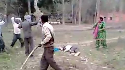 Hair-raising moment: Brave woman brandishing sticks fights off five men who were mercilessly thrashing her husband