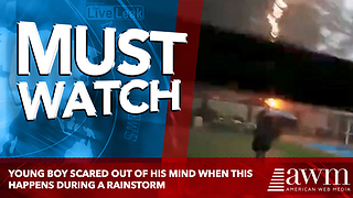 Young Boy Scared Out Of His Mind When THIS Happens During A Rainstorm - Video