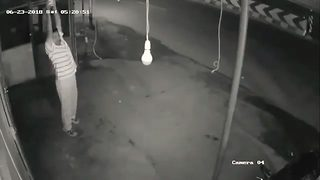 Bizarre cctv footage shows hilarious moment man exercises – only to steal lightbulb