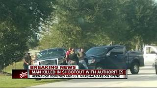 Man killed in shootout with authorities - Video