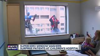 Superheroes washing windows surprise kids at Children's Hospital of Michigan - Video