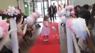 Flower girl repeatedly stops to blow kisses - Video