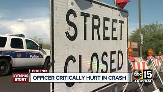 Phoenix officer still in critical condition after crash - Video