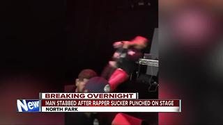 Man stabbed after rapper punched at concert - Video