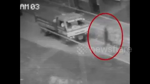 'Ghost' caught on camera walking through traffic in the Philippines