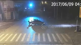 Scooter driver flies onto car roof during crash - Video