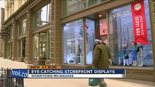 Downtown businesses decorate empty store fronts - Video