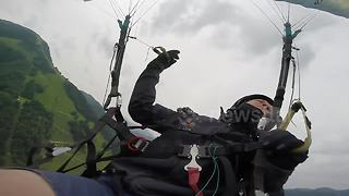 Man experiences terrifying paragliding accident in Austria - Video