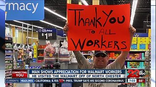 Man thanks Walmart employees with sign