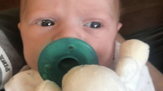 Newborn baby adorably sneezes on camera