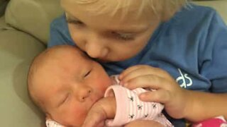 Brother shows his love for newborn sister