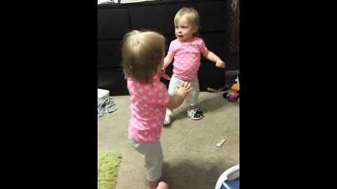 Baby girl adorably amused by squeaky shoes