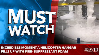 Incredible moment a helicopter hangar fills up with fire- suppressant foam - Video