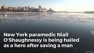 Hero Paramedic Saves Man From Frigid River - Video