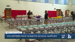 Volunteers pack donated school supplies at Lansdowne Elementary School