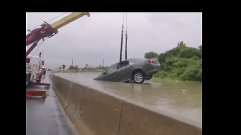 Cars Pulled From Flooded Toronto Highway